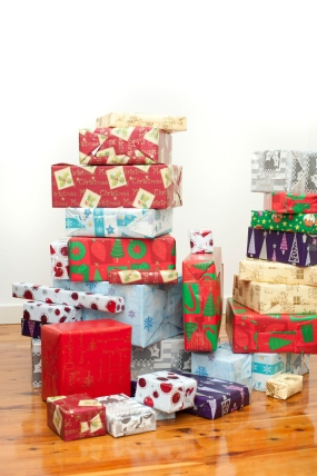 Stacks of multicoloured Christmas gifts C.C. lic
