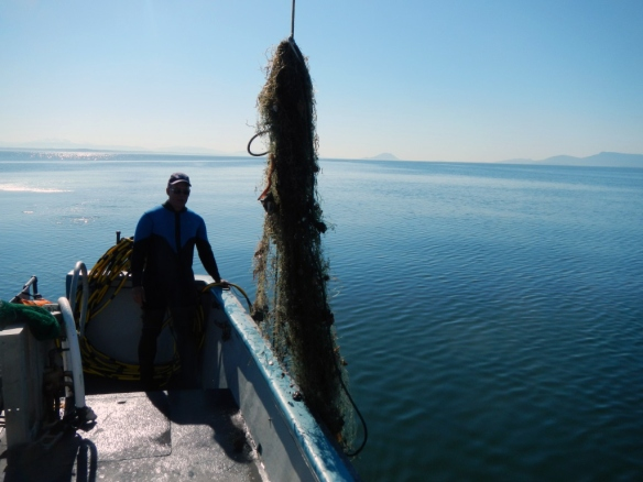 Diving for Debris-Fishing net removal boat. Photo courtesy of NOAA